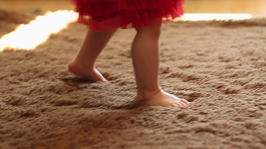 Charming small legs doing first steps, slow motion | Shutterstock HD Video #7548226