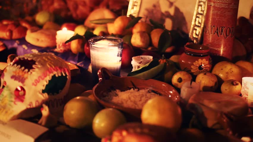 Day of the dead offering altar with bread ¨Pan de Muerto¨ chocolate and amaranto skulls and flowers