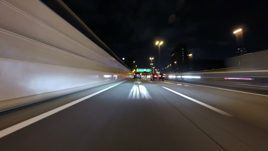 (Driver POV) Nightlapse through the city illumination of central Tokyo highway. | Shutterstock HD Video #7600756