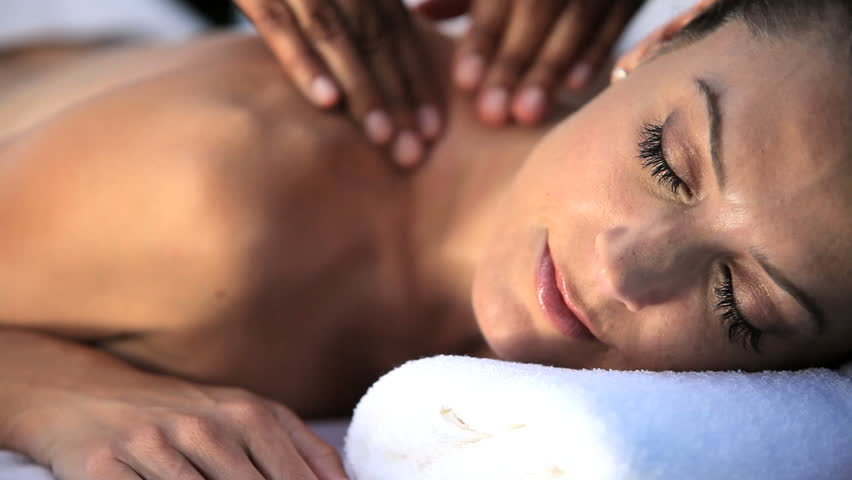 Sophisticated lady having massage treatment at a luxury health & beauty spa in close-up