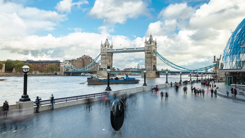 Time Lapse of Tower Bridge, black egg shaped sculpture on the South Bank and City Hall, The Scoop, London, UK