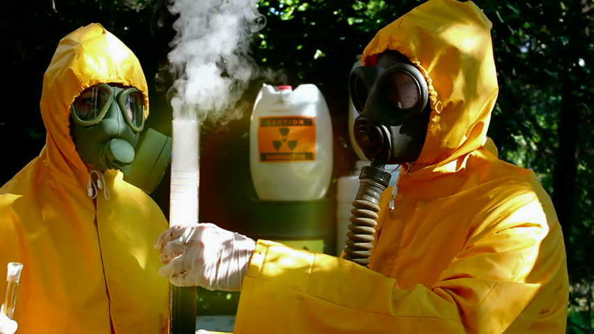 Tempestuous chemical reaction ; Two chemical technicians with gas masks and protective suits carried out disposal of toxic substances,video clip