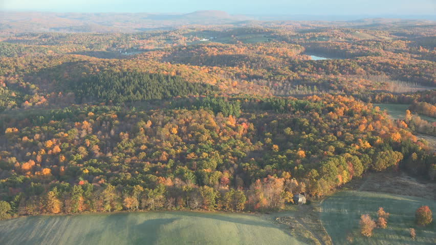 Flight along colorful field. 4K, UHD sweeping fall aerial view Hudson Valley near Berkshires, fall tree colors and fields sparkle in early morning light. | Shutterstock HD Video #7662976
