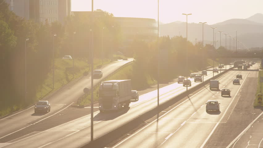 SLOW MOTION: Highway traffic at sunset #7663186