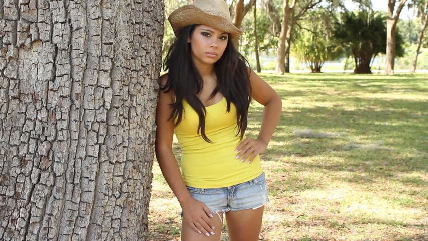 Pretty Latina portrait in the park