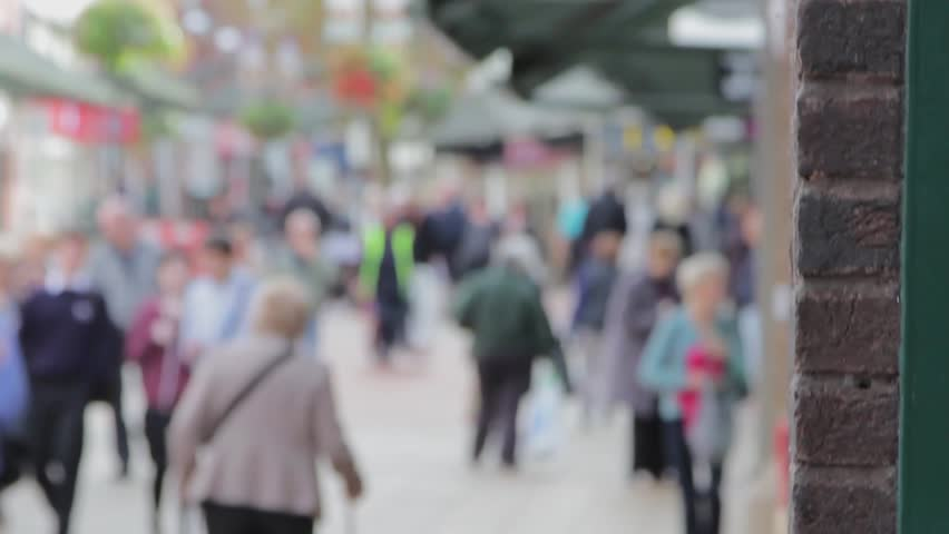 Large Anonymous Crowd Walking Busy Lichfield Town Centre Precint Street - Shallow Depth of Field - Out of Focus - October 2014  Location: Lichfield, Staffordshire, England, UK  Source: 5D Mkiii #7679026