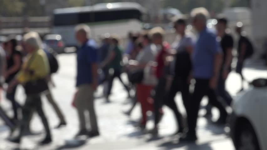 ROME, ITALY - OCT. 2014: Using crosswalk, defocussed pedestrians cross street both ways against white pavement; traffic patiently waits. 4k #7714714