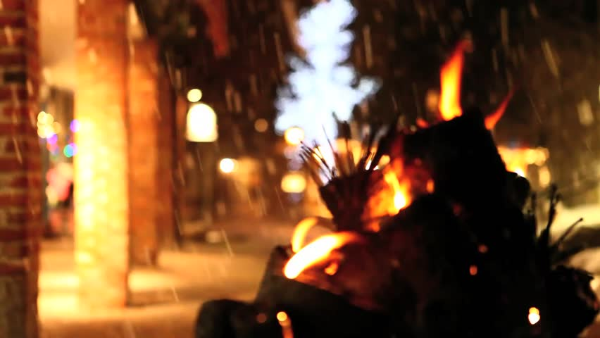 Snow falling on an open flame
