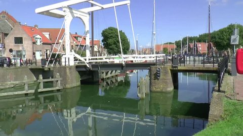 Enkhuizen,The Netherlands,-september 2014 province of North Holland :An old draw bridge opens for a sailing yacht in the historic harbour of Enkhuizen