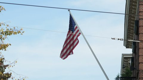 Close of flag of USA hanging from consulate in Amsterdam.