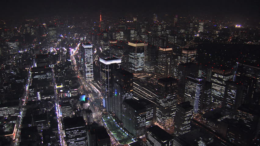 Aerial Metropolis night illuminated offices skyscrapers Tokyo Station city blocks transport Central Business District Japan Asia | Shutterstock HD Video #7792132