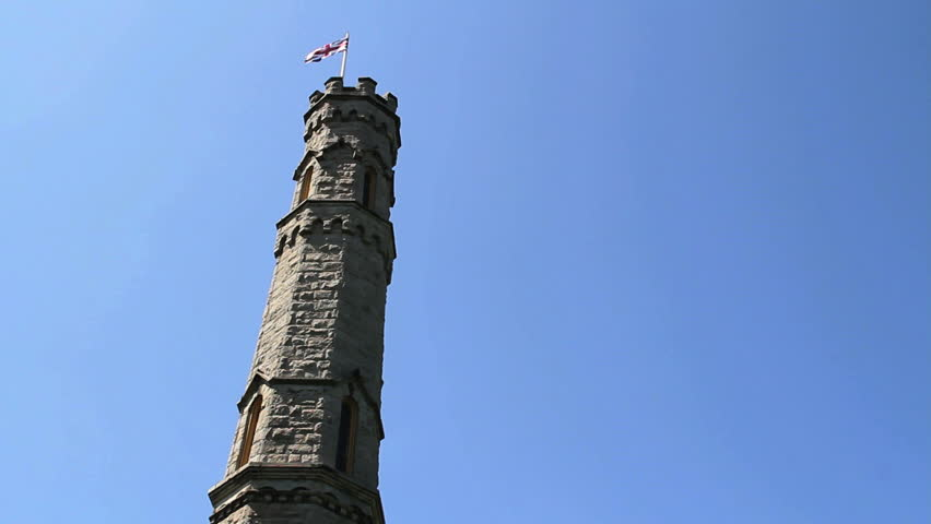 Union Jack (British Flag) flies from leaning castle tower