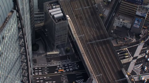 Aerial Metropolis view Shinkansen TGV Bullet train motion city skyscrapers downtown Tokyo Expressway Japan