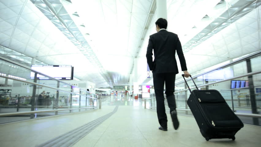 Young Asian Chinese smart suit male business travellers airport terminal atrium conference meeting professional corporate management | Shutterstock HD Video #7810051