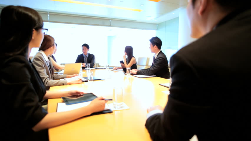 Ethnic Asian Chinese smart businessmen businesswomen corporate management conference meeting wireless laptop device planning | Shutterstock HD Video #7852156