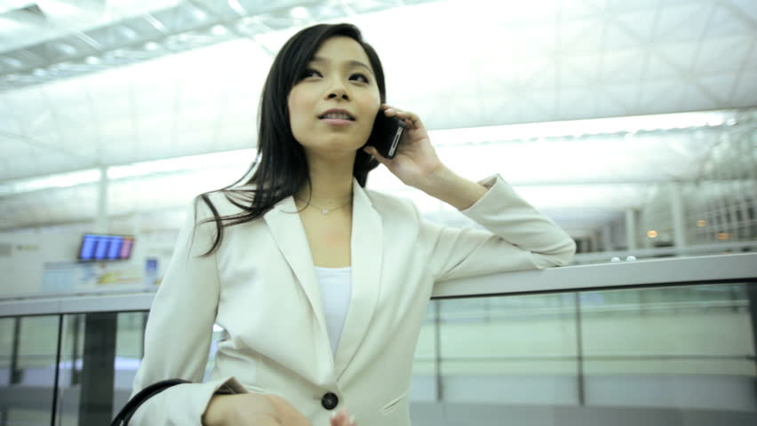 Wireless cloud smart phone email communications young ethnic smart female business traveller airport terminal conference meeting   Shutterstock HD Video #7853866