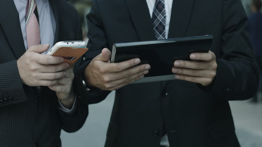 Businessmen using tablet and smartphone: working, coworker, business, web, wi-fi | Shutterstock HD Video #7858846