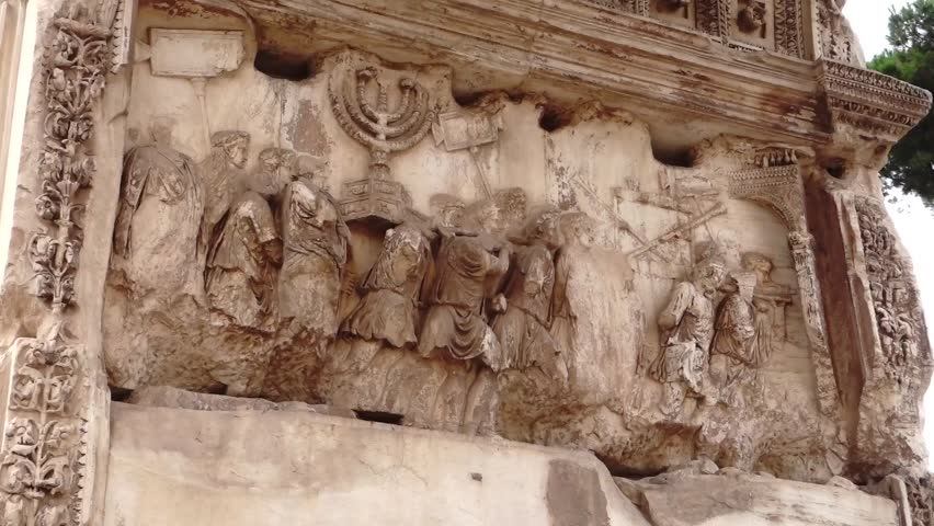 Detail of the carving on the inside of Titus' Arch in the Roman Forum. It depicts the Roman army carrying off the treasures of the Jewish Temple, including the Menorah.