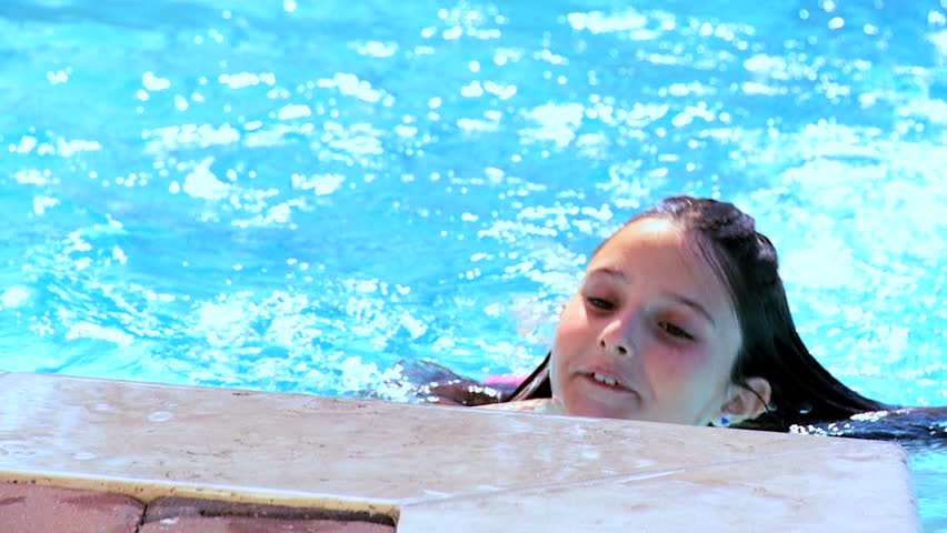Young girl having fun in her family swimming pool 60 FPS