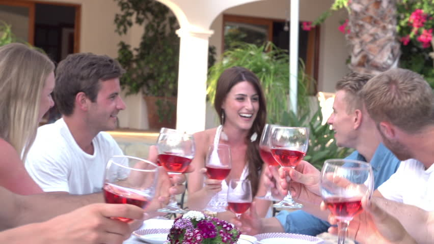 Dinner Party Video Part - 21: Slow Motion Sequence Of Friends Making A Toast Before Enjoying Meal  Outdoors Together. Shot On