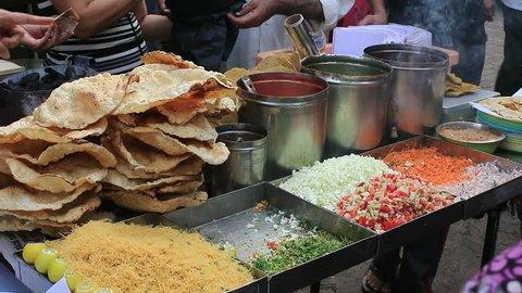 Fast food Masala Papad available on roadside food stalls in Mumbai.