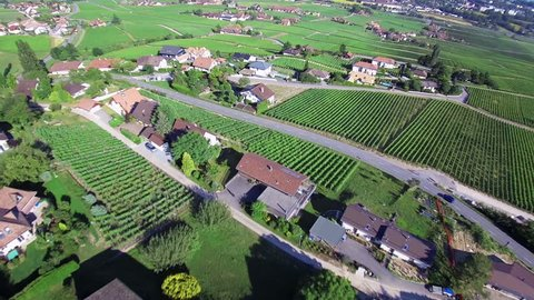 Swiss country side from above : lake Geneva area Aerial shot of a swiss village on a bright sunny afternoon. Switzerland from the sky.