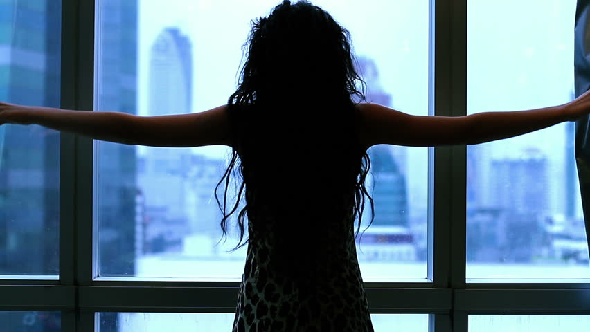 Girl opens the curtains in the morning | Shutterstock HD Video #7955056