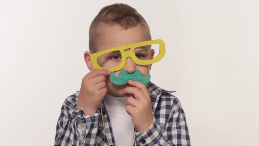 Boy playing with toy mustaches   Shutterstock HD Video #7977406