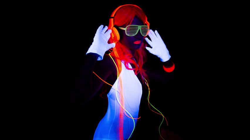 Fantastic video of sexy cyber raver dancer babe filmed in fluorescent clothing under UV black light  | Shutterstock HD Video #8002573