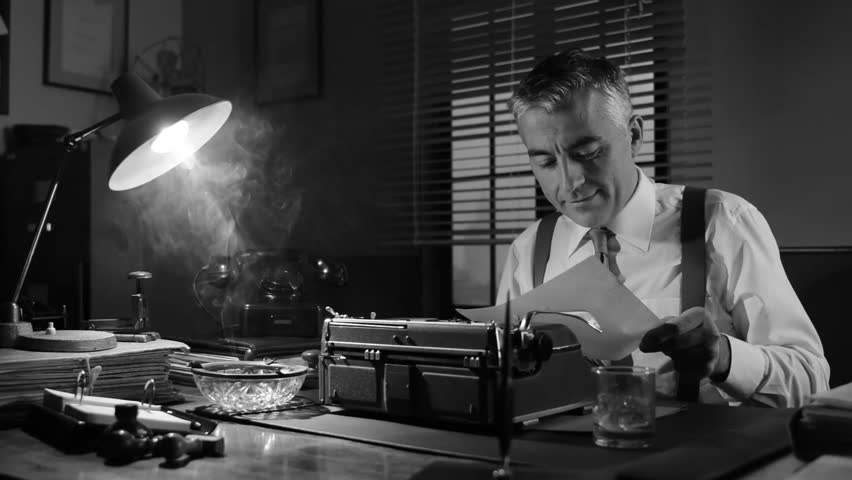 Vintage Journalist Working Late At Night At Office Desk