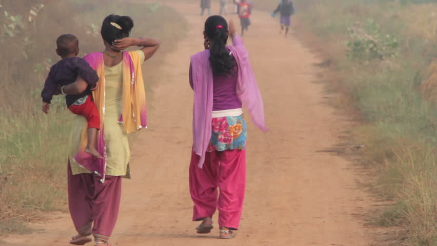 Indian women with children are on a rural road #8026102