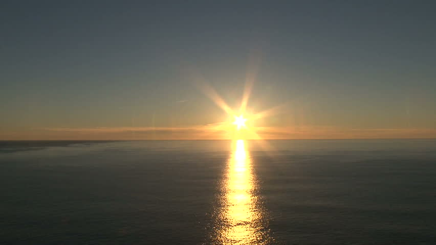 Sunrise time lapse over Pacific Ocean horizon on beautiful, clear morning in Oregon.