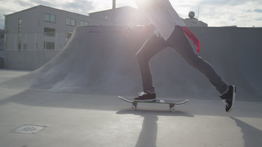 SLOW MOTION: Skateboarder jumps on his skate and starts cruising | Shutterstock HD Video #8060719
