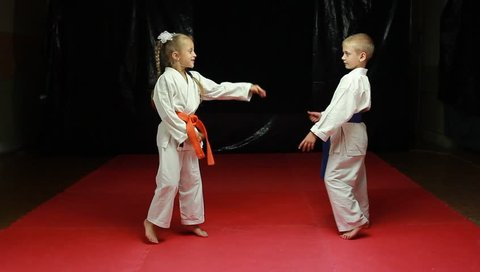 Karate - Happy children train throws and then hug each other