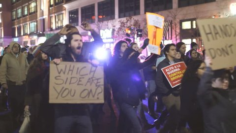 PROVIDENCE, RI - DEC 1: People protest the streets in reaction to the Ferguson shooting, taken on December 1, 2014 in Providence, Rhode Island. Sequence of multiple clips with audio.