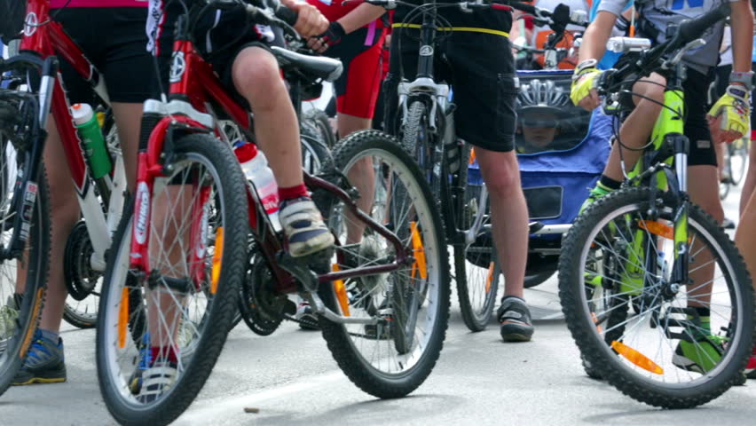 VRHNIKA, SLOVENIA - AUGUST 2014: Panning over a group of bicycles. Close up bicycles waiting for start of competition. | Shutterstock HD Video #8108806