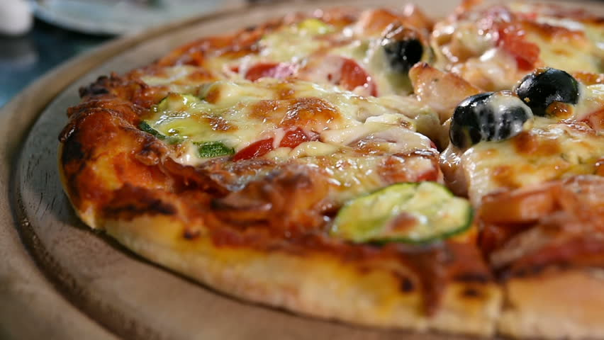 Close up of pizza on wooden board.  | Shutterstock HD Video #8140315