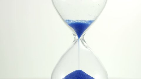 Hourglass. 4K UHD 2160p footage Hourglass against a white background. 3840X2160 4K UHD video