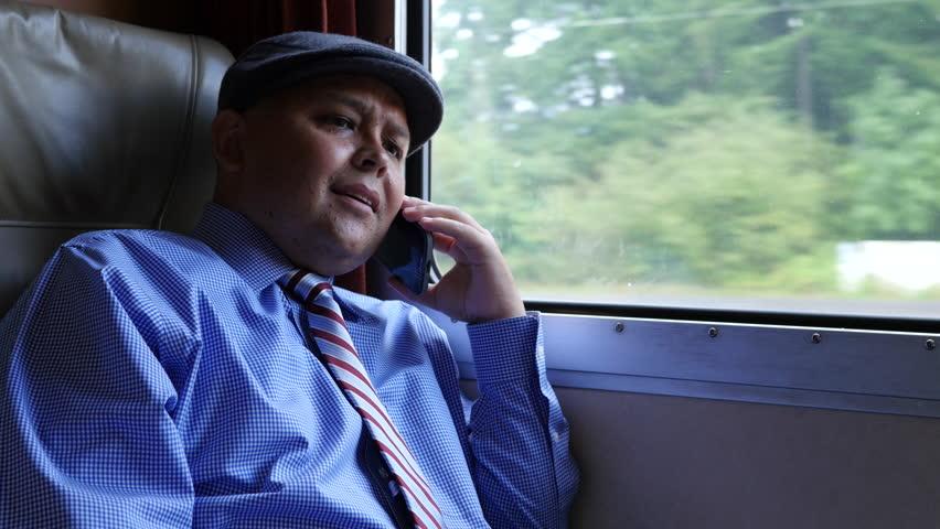 Man using cellphone on train | Shutterstock HD Video #8160286