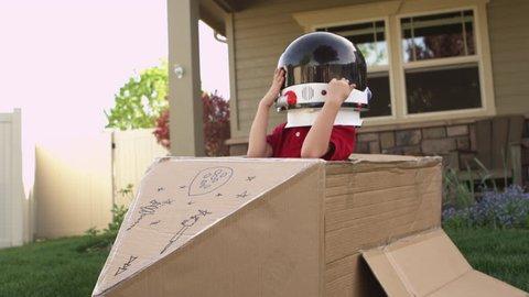 Little boy pretending to be astronaut