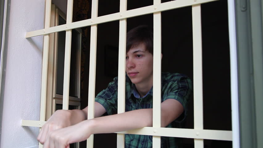 Juvenile Prison, Teenager Incarcerated, Behind Stock Footage Video (100%  Royalty-free) 8202826   Shutterstock