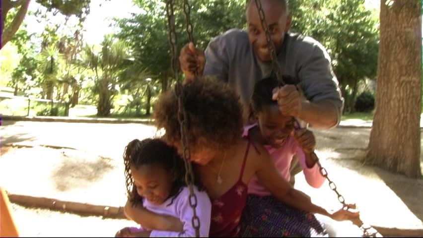 Family In Park On Swing | Shutterstock HD Video #8206216