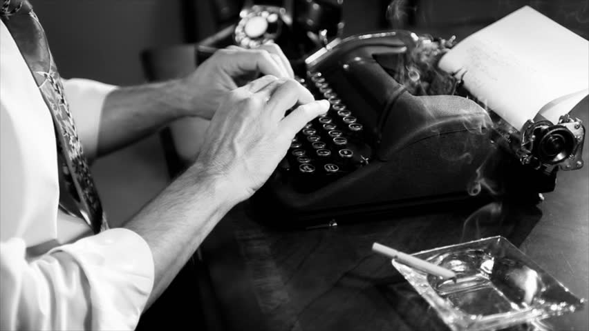 The camera pans up as a lit cigarette is picked up by a reporter typing on a manual typewriter. Film Noir