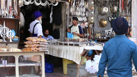 AMRITSAR, INDIA - SEPTEMBER 28, 2014: Unidentified Sikhs and indian people in the gift shop next to the Golden Temple in Amritsar. Sikh pilgrims travel from all over India to pray at this holy site.