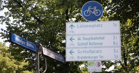 Focus on Background Berlin Intersection Blurred Street Sign Not Focused Board Direction Info Route Indicator Day - Version 2 ( Ultra High Definition, UltraHD, Ultra HD, UHD, 4K, 2160P, 4096x2160 )