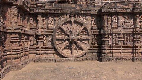 beautiful carvings on stone wheel in ancient Surya Hindu Temple Konark, Odisha, India