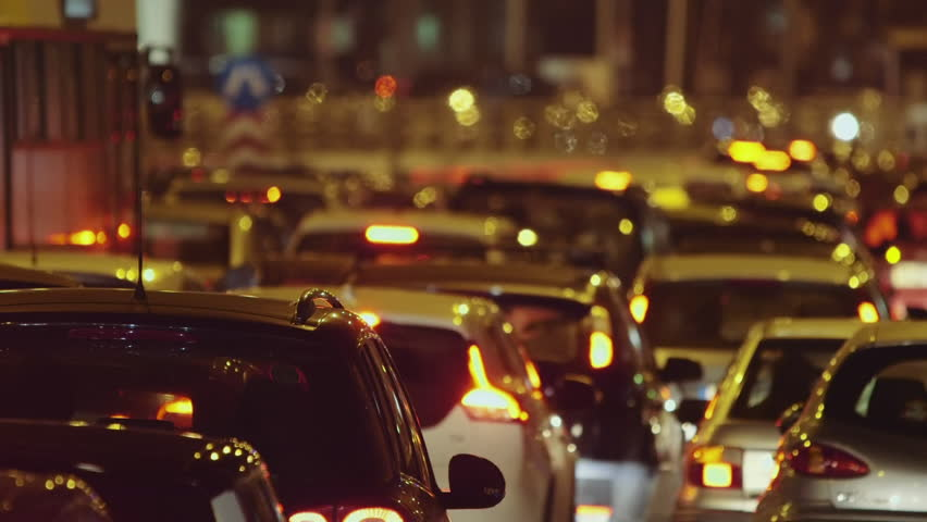 A compilation of car traffic jam real time clips taken at night at a busy avenue in Athens,Greece using a long lens.Due to Christmas working shop hours employees retuning home cause a traffic jam.
