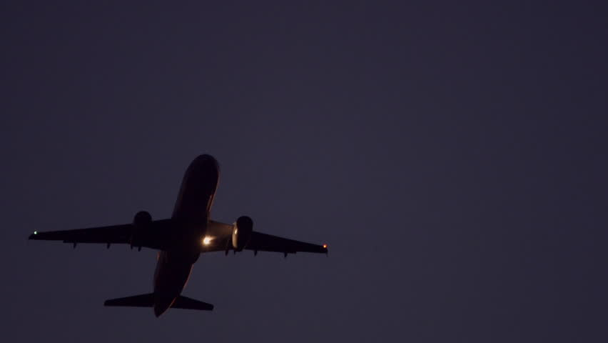 Real Time Telephoto Shots Of A Passenger Plane Taking Off At Night Who Just