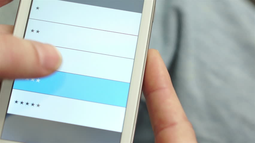 Anonymous man taking a quality of service survey on his mobile phone or device. | Shutterstock HD Video #8359237