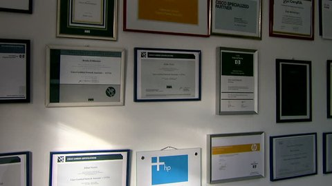 MONTENEGRO - PODGORICA 2009 - Office wall covered with diplomas